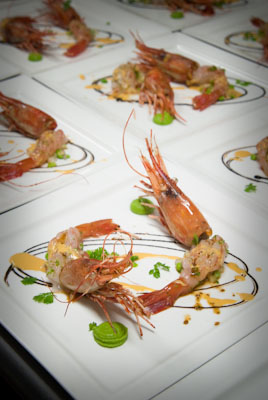 "Finished dish Santa Barbara spot prawn ""ceviche"" with sweet peas, uni veloute and black garlic"