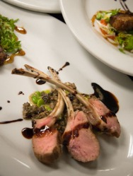 Boar Chops foreground - Duo of wild boar, chops with morel mushroom fava bean fricassee, crispy belly with tomato and pepper confiture