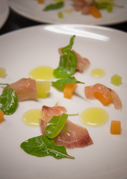 "Compressed melon, Japanese Yellowtail ""prosciutto"", arugula, lemon and Terre Bormaine Riviera Ligure Olive Oil"